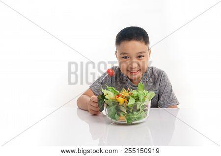 Young Boy Eat Salad