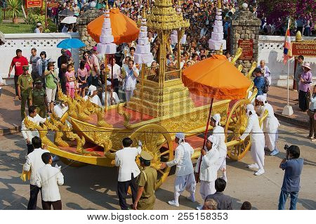 Luang Prabang, Laos - April 16, 2012: Unidentified People Take Part In The Religious Procession Afte