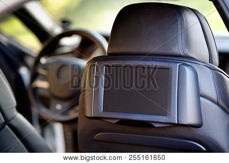 Car Inside. Interior Of Prestige Luxury Modern Car. Display For Back Seats Passenger With Copy Space
