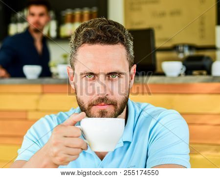 Man Bearded Serious Face Needs Energy Charge. Caffeine Makes You More Energetic. Serious Guy Enjoy C