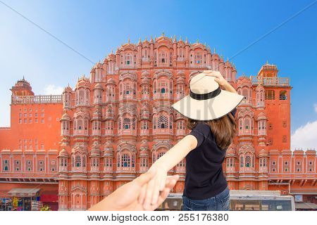 Couple Travelers Man And Woman Follow Holding Hands At Hawa Mahal Palace In Jaipur, Rajasthan, India