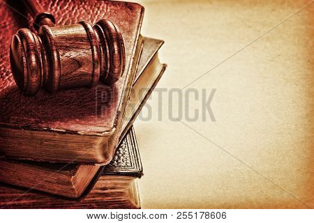 Gavel And Old Books  - Gavel, A Pile Of Books, And Space For Text On Textured Background.