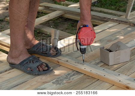 Drill Wood Workshop. Woodwork And People Concept - Carpenter With Battery Power Drill Drilling Wood