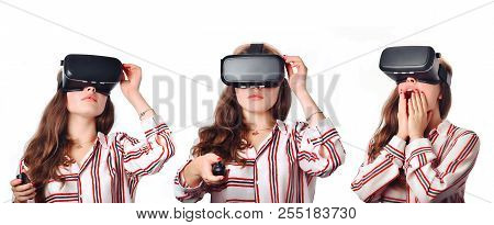 Young Woman Using A Virtual Reality Headset And Smiling At White Background. Studio Image