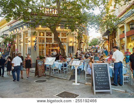 Athens, Greece - June 30, 2018. A Terrace Of A Greek Restaurant At Plaka Neighborhood Of Athens City