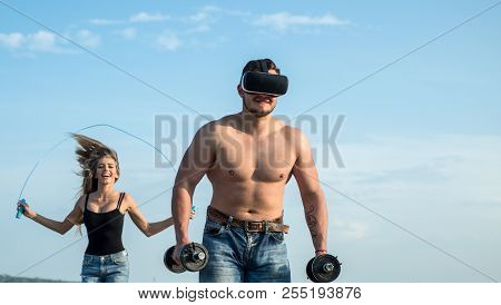 Power And Sport. Power Man With Muscular Torso. Power Sportsman In Vr Headset Training With Dumbbell