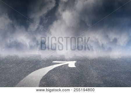 Arrow On Dull Sky Background. Way And Forward Concept