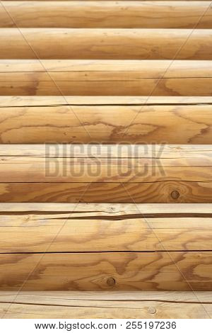 Facade Of A Log House Textured Horizontal. Wooden Texture Background Wall Of Blockhouse