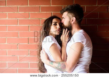 Moments Of Intimacy. Couple In Love Hugs Brick Wall Background. Couple Find Place To Be Alone. Girl