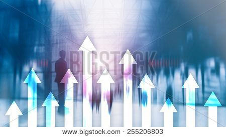 Up Arrow Graph On Skyscraper Background. Invesment And Financial Growth Concept.