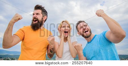 Woman And Men Look Emotional Successful Celebrate Victory Sky Background. Celebrate Success. Behavio