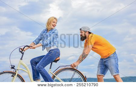 Support Helps Believe In Yourself. Support And Friendship. Woman Rides Bicycle Sky Background. Servi