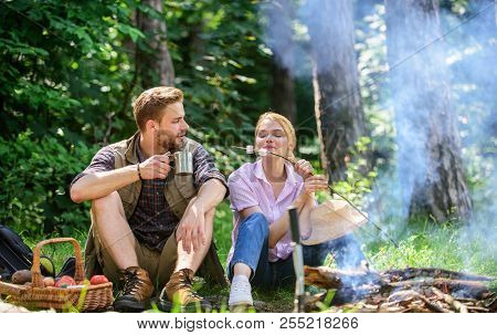 Couple Take Break To Eat Nature Background. Couple In Love Camping Forest Hike. Food For Hike And Ca