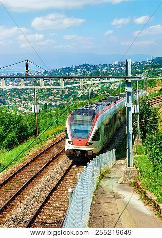 Lavaux, Switzerland - August 30, 2016: Running Train In Vineyard Terraces Hiking Trail Of Lavaux, La