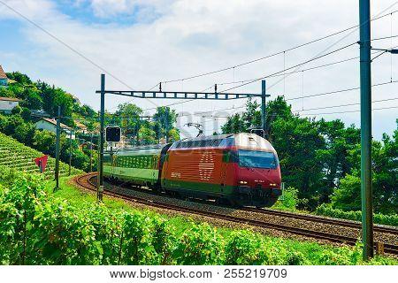 Lavaux, Switzerland - August 30, 2016: Running Train And The Railroad, Lavaux Vineyard Terrace Hikin