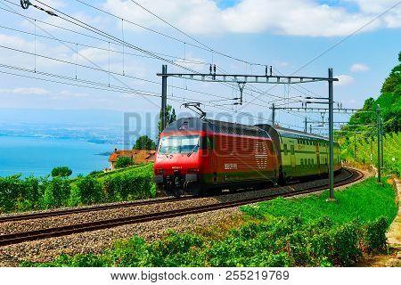Lavaux, Switzerland - August 30, 2016: Running Train At The Railroad At Lavaux Vineyard Terrace Hiki