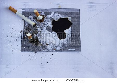 Cigarette cigarette stubs extinguished about a shot of pregnancy, pregnancy and smoking, cigarette and gestation poster
