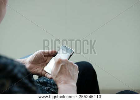 Elder Woman Holding Mobile Phone. Elderly Senior Female Texting Message, Using App With Smartphone A