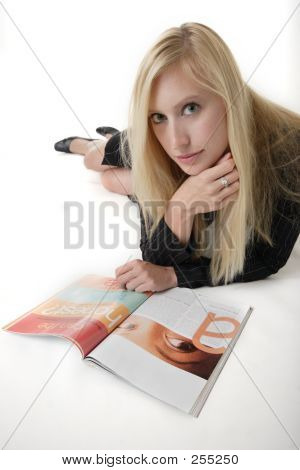 Working Mom Relaxing Reading A Magazine