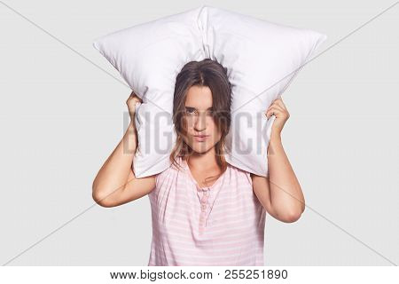 Irritated Female Cant Sleep Because Of Noise, Tries To Cover Ears With Pillow, Has Sleepless Night A
