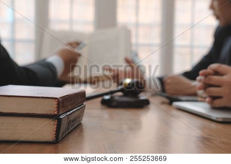Lawyer Giving Advice To Business People. Businessman Discussing Legal Legislation At Law Firm. Judge