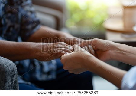Hand Of Elderly Woman Holding Hand Younger Woman, Helping Hands, Take Care For The Elderly Concept.