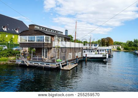 Copenhagen, Denmark - July 9, 2018. Beautiful Ships And A House On The Water On The Canal. Water Tra