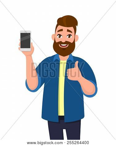 Happy Young Man Showing Smartphone And Showing Thumbs Up Or Like Sign. Mobile Phone Technology Conce
