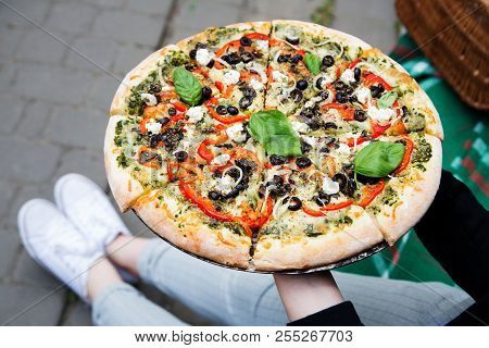 Freshly Baked Take Out Vegetarian Italian Pizza Being Held By A Girl In The City