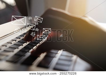 Close Up Of Woman Hand Using Laptop With Email Icon For Sending Email Concept.selective Focus..