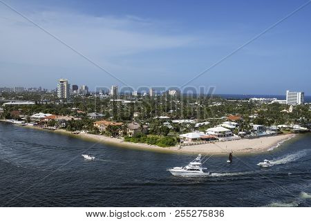 A Scenic View Of The Fort Lauderdale Coastline With Beaches, Boats And Luxury Homes.