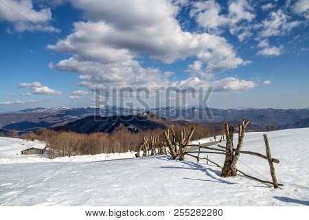 Winter Landscape In The Coutryside And Sky With Clouds, Italy.