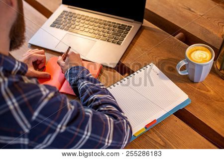 Cropped Image Of Casual Business Man Or Freelancer Planning His Work On Notebook, Working On Laptop
