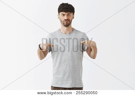 Man Asking Advice From Wife About His Outfit, Pointing At Chest With Doubtful And Unsure Expression,
