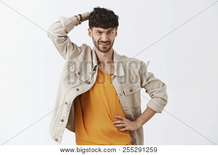 Man Facing Problematic Decision Being Confused And Uncertain Scratching Back Of Head With Clueless A