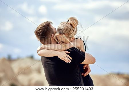 Man Makes A Marriage Proposal To His Girlfriend. Engagement Of A Couple In Love In Nature. The Guy W
