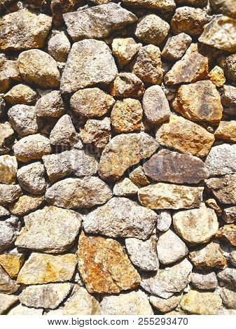Abstract Background Made With Rock. Closeup View Of Rock Wall. Rock Wall Texture And Background For