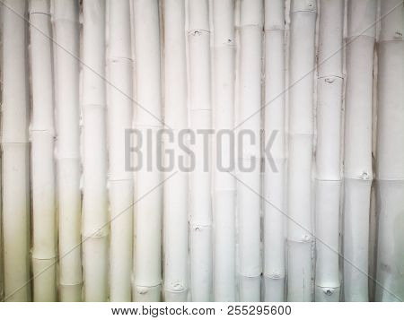 Home decoration concept and abstract background made with rough tile, which mimic bamboo panels. Closeup view of white rough tile. Tile texture and background for wall design. Texture of rough tile and copy space. poster