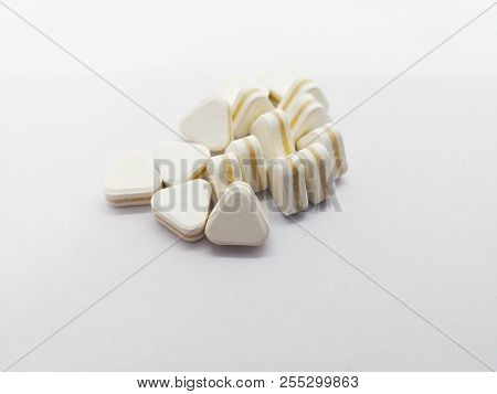 Medication Concept. Many Triangle White Pills Are Antacids, Used For Relief Stomachache And Reduce F