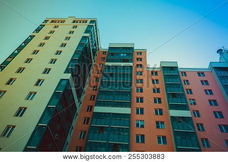 The Windows Of A High-rise Multi-storey Residential Building. Buildings And Architecture. Multi-stor
