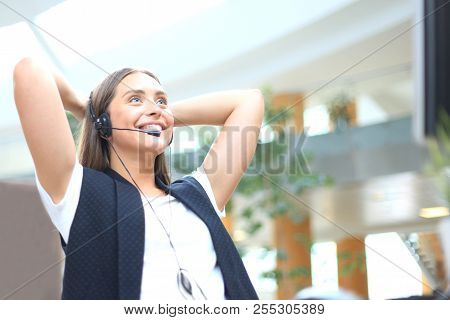 Call Center Operator In Headset Resting At Workplace In Office.