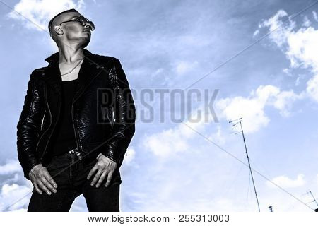 A man looking at the sky. Streetstyle. Freedom feeling.