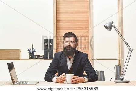 Business, Office, Technology Concept. Smiling Businessman With Laptop Computer And Coffee At Office.