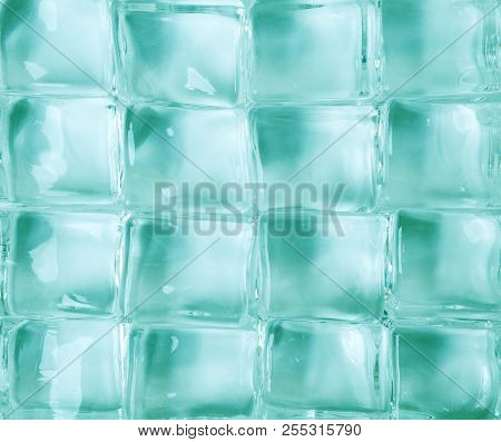A Group Of Crystals On A Green Background
