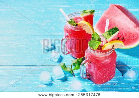 Watermelon Summer Cocktail With Ice And Mint Leaves. Cold Refreshment Drink On Blue Wooden Backgroun