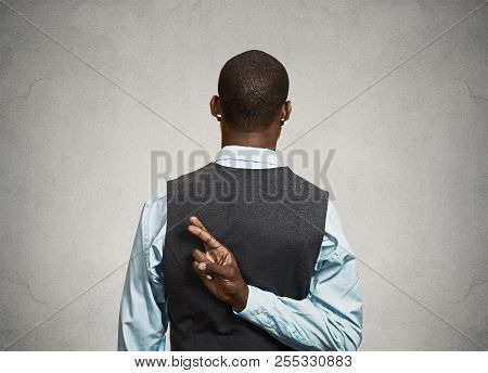 Closeup Young Businessman Crossing Fingers Behind His Back. Conceptual Image Business Man With His F