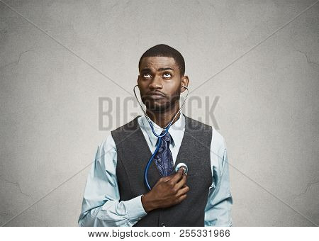 Closeup Portrait Executive Man, Business Person, Worker Listening To His Heart With Stethoscope Look
