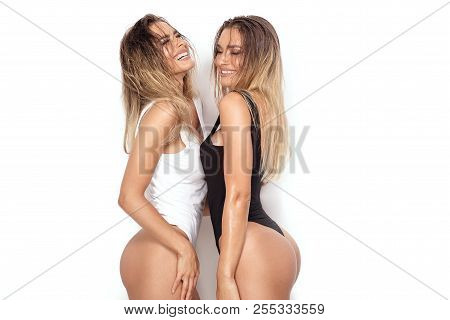 Sensual Twins Women Posing On White Background.