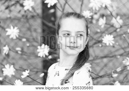 Spring, Easter And Holidays Celebration Concept. Little Girl On Floral Blossom In Spring. Child With