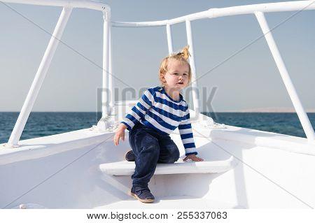 My First Travel. Baby Boy Enjoy Vacation On Cruise Ship. Child Cute Sailor Yacht Sunny Day. Adventur